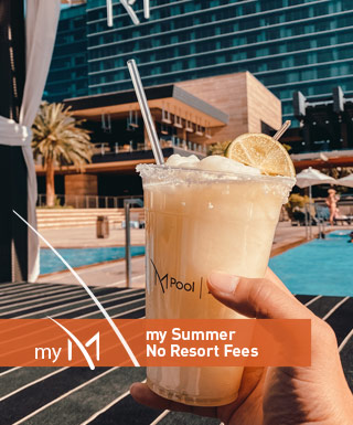 "hand holding orange drink at m pool with text ""my m my summer no resort fees"""
