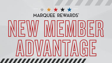 "Logo with words ""Marquee Rewards: New Member Advantage"" outlined in red on a gray background."