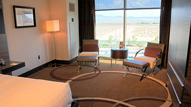 Two chairs by the window of the executive room at M Resort.